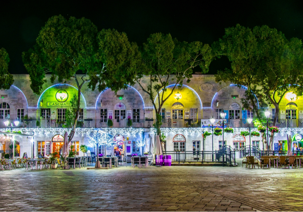 Christmas lights night view of bars and restaurants on the grand casemates square in Gibraltar